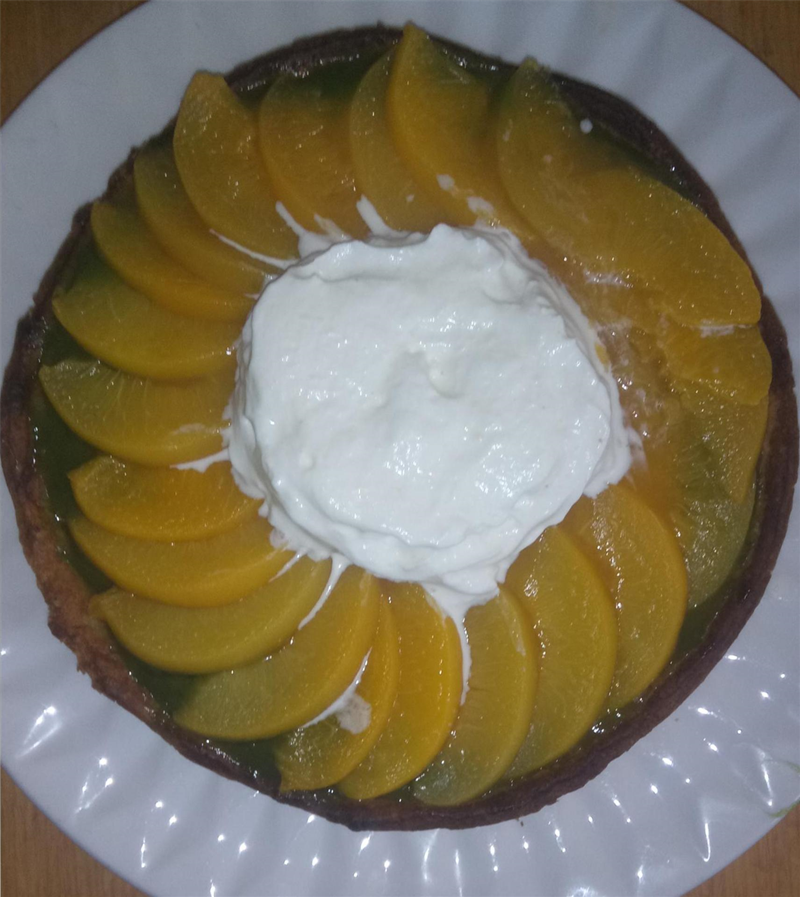 Kanyinsola Richard-Akinyemi Green Cake decorated with orange peaches and oranges and white cream.png
